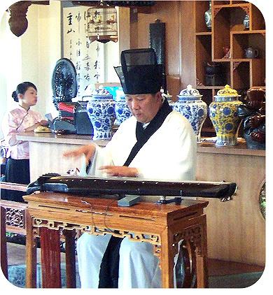 Zhu Xi's standard Shenyi with Dongbo Cap. Pictured is Yang Qing, Ruan and Guqin player/teacher in Beijing.